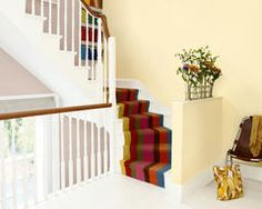 Paint a hallway from floor-to-ceiling in welcoming primrose yellow.