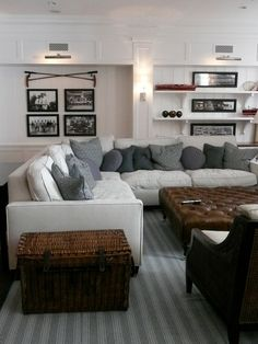 Giannetti Home: Comfortable family room with vintage sports theme. White wainscotting wall paneling, ...
