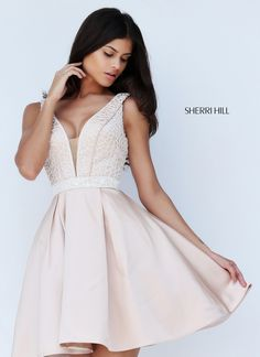 Take a spin in Sherri Hill 50819. This beautiful, short, A-line dress features an illusion plunge neckline with sheer nude panel, and open V-shaped back. Intricate beading embellishes the bodice and waistband. The pleated skirt adds a lovely flare that will make heads turn. This dress is perfect for celebrating a birthday, family get together, charity event, or prom. var _currentScript = document.currentScript || null; (function () { var script = document.createElement('scrip...