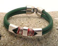 Men's Bracelet. Men's Leather Bracelet Mens Green leather multi strand bracelet with silver plated spacer and clasp.