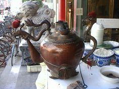 "Chatang - Literally mean ""tea soup"" is Tianjin's traditional snack.  The way chatang being served at stalls is as attractive as the soup itself. The water is boiled in a big copper pot whose spout is usually fashioned into a dragon's head. While making the soup, the skilled chatang maker holds severaI bowls in one hand and pours the boiling water into them from quite a distance."
