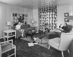Relaxing in the living room of a Lustron House, ca. 1947-1950.