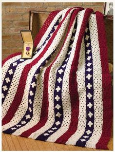02600Let Freedom Ring With This Granny Square Patriotic Crochet Afghan. This eye-catching crochet patriotic afghan designed by Carolyn Pfeifer is made entirely from granny squares. Alternating stripes of red, white and blue, white create an attractive. The fringed edges providea nice finishing touch. The finished size per the pattern is 46″ x 58″ excluding the …