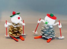 tiny skiing pine cone snowmen. love it.
