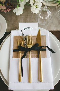 Wedding tables cape, Gold cutlery, lavender sprig, white napkins, black ribbon, calligraphy escort card