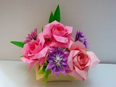 Origami roses ( Naomiki Sato ) origami little flower( Carlos Bocanegra )  folded by Majomajo origami roses tutorial ( Masahiro Ichikawa )http://www.youtube.com/watch?v=CrWVUYiMftE