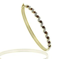 18K Gold over Silver Diamond Accented Garnet S Design Bangle SilverSpeck.com. $39.99. Measures 4.8mm W, 7.25 inches long