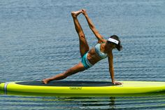 One of our favorite SUP Fitness/Yoga Instructors - Suzanne Yeo - bending in a way we only dream of. Sweet! And she's on one of our boards which is nice!    #yoga, #SUPyoga, #fitness, SUP, Stand Up Paddleboard    www.paddlesurfwarehouse.com