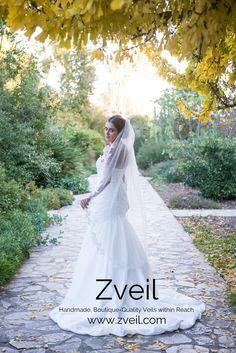Exquisite bouquets of floral #lace applique adorn the edge of this stunning waltz-length #veil. #WeddingVeils #Wedding