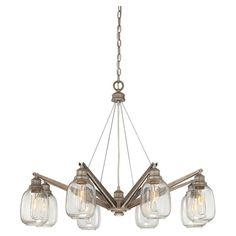 Cast a warm glow in your living room or den with this eye-catching chandelier, showcasing clear glass globes and an industrial steel finish....