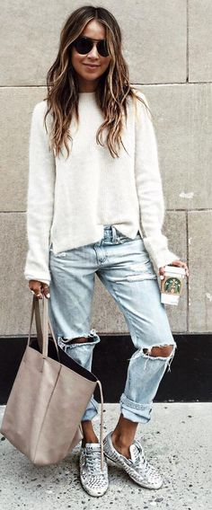 white knit. ripped boyfriend jeans. trainers.
