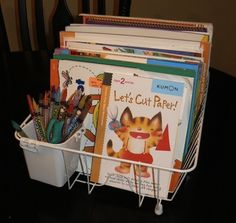 better use for a dish drain - coloring book and crayon storage!
