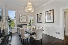 Contemporary chandelier adjacent to traditional crown moldings