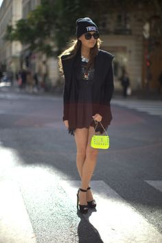 i love this mix of street/chic... beanie and tee with skirt and sparkle :)