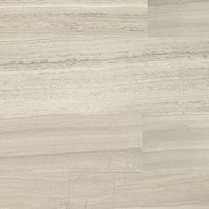 """Limestone Collection"" by Daltile: Natural stone tile shown in Chenille White (vein-cut)."