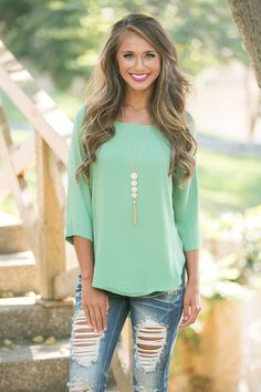 We absolutely adore the soft jade green color of this 3/4 sleeve blouse! It's simply perfect for pairing with jeans, jeggings, or capris for a sweet look as you transition from summer to fall!