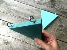 """Here's a really simple garden project – DIY wooden bunting. We're building a """"treehouse"""" for the kids in our garden. I say """"treehouse"""" because there are no trees in our garden. In fact calling it a garden is quite a compliment, it's a courtyard that now has a shed on stilts in the corner …which needs a bit of jazzing up. So to decorate it I thought some bunting might be nice, but fabric bunting always ends up looking kind of ratty after a while when it's outside, so I used some left-over…"""