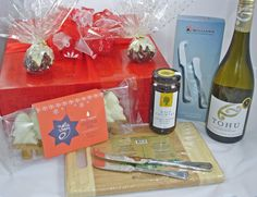 New Zealand Wine Gift Box - Funky Gift Boxes Ltd. $105 Gift Box includes: NZ wine Tohu Sauv Blanc, 2 small Xmas puddings, Cheeseboard, cheese & pate knife set, Xmas cookies, chocolate dessert topping. Couriered NZ wide. #Auckland Gift, #New Zealand made, #Christmas corporate gifts