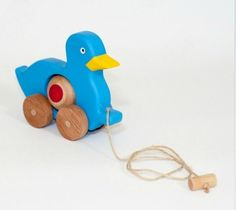 Hey, I found this really awesome Etsy listing at https://www.etsy.com/listing/102396858/lovely-handcrafted-wooden-duck-on-wheels