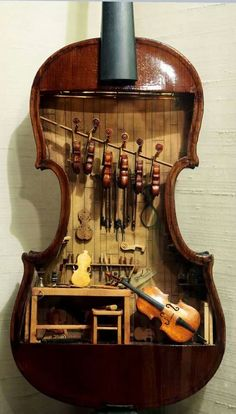 The Arizona Daily Star reports: This 18th-century violin makers shop by W. Foster Tracy, 1979, is a miniature built inside a full-size violin. It was on display at the Mini Time  A Mini Time Machine Museum Showcases Tiny Violins. Really Tiny Violins. Machine Museum of Miniatures, 4455 East Camp Lowell Drive, on June 4 in Tucson, Arizona. All completed instruments and tools are fully functional in this model.