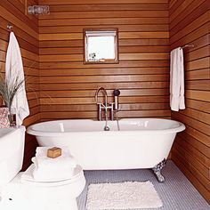 Wood walls and nautical light fixtures give this room ship-style elegance. Cedar panels in lieu of tile simplify construction.