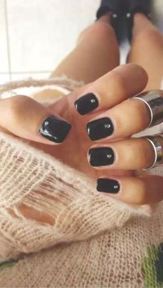 Black nails with single tiny crystal #mani #holiday