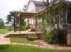 Pergola on deck with two sets of steps