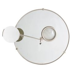 A Satellite Mirror by Eileen Gray. Created for her home in the south of France, 1927. This mirror is a later reissne by Echart International c.1960/1970.  http://www.lorfordsantiques.com/product/satillite-mirror