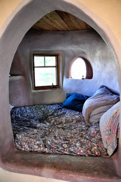 This is a sleeping nook in Carole Crews' adobe brick dome home in Taos, NM. The photo is from this blog: http://evolutionaryearth.wordpress.com/2010/06/20/dome-time/