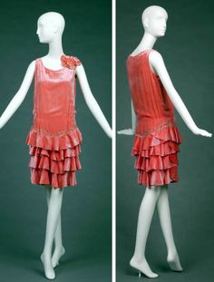 Evening dress, ca. 1928-30. Salmon pink silk velvet with round neckline, rhinestone bead work at dropped waist and on left shoulder flower, three rows of ruffles attached to under dress, shoulder smocking. Goldstein Museum of Design, Univ. of Minnesota