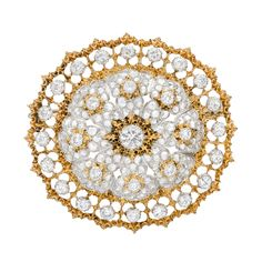 "Estate Buccellati Pierced 18k Gold & Diamond Circular Brooch , Circular-shaped brooch, accented by rose-cut and circular-cut diamonds, the diamonds weighing approximately 3.17 total carats, mounted in pierced 18k yellow and white gold, signed Buccellati Italy. Just over 1.5"" diameter."
