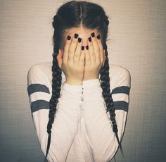 Dutch pigtail braids are a trendy way to wear your hair this Spring.