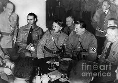 PUTSCH ANNIVERSARY, 1937. Leaders of the Third Reich celebrate the anniversary of the 1923 Beer Hall Putsch at the beer hall in Munich where it was launched. Left to right: Franz Ritter, Rudolf Hess, Adolf Hiter, Hermann Goering, and Max Amann. Photograph, 9 November 1937.