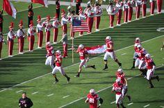Nebraska Cornhuskers football team running onto Tom Osborne field at Memorial Stadium in Lincoln, NE.  #huskers