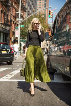 A full pleated skirt paired with a black knit top. A full pleated skirt paired with a black knit top. Mode Outfits, Fashion Outfits, Womens Fashion, 30 Outfits, Skirt Fashion, Modest Fashion, Fashion Trends, Fashion Clothes, Stylish Outfits