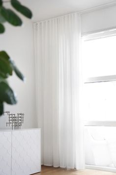 YESSSS...Floor to ceiling opaque white curtains that will keep the peepers out, still let light in, and brighten the room at any given hour
