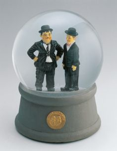 Close-up of figurines of Laurel and Hardy in a snow globe