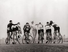 Love the contrast of the woman with the cyclists - wouldn't mind having this on my wall.