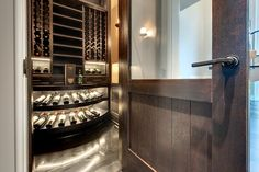Custom Wine Cellar - Two-level, illuminated custom apron display that elegantly showcases specific wines  Wagner St., Glenview, Glenview Haus Photo Gallery, Chicago