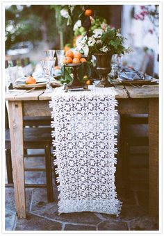 We love the idea of a white lace table runner at a simple summer dinner party- perfect for for a rustic meal outdoors with friends and family.