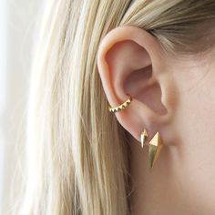 When I was a teen, there was nothing cooler than multiple ear piercings. But that was before the ear cuff was introduced and the ear stack got so much cooler. Whether stacked up the ear, sitting al… Fake Gauge Earrings, Punk Earrings, Gothic Earrings, Gold Earrings, Punk Jewelry, Body Jewelry, Fashion Jewelry, Gold Jewellery, Tumblr