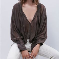 FP One Star Point Blouse Found the look: Soft, feminine lines define this jersey blouse from Free People. The semi-sheer piece is detailed with a self-tie neck, flared fluid cuffs and finished in an all-over monochrome star print. Free People Tops Blouses