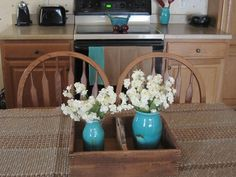 Can't forget the attached kitchen...no tablecloth...how 'bout a rug? Works for me!