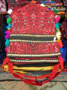Hand embroidered handbag from Sindh. Lok Virsa Mela is a folk heritage annual event in Spring season in Islamabad, where craftsmen and craftswomen from all provinces of Pakistan gather and display their work and sell their handcrafted artwork of all kinds. There is a 'Artisans at work' segment where artisans show how they produce an artwork.  Photography: Zehra Naqavi (Architect/artist).  April 11, 2012  All photographs are watermarked.
