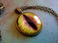 Check out this item in my Etsy shop https://www.etsy.com/ca/listing/518400020/green-dragon-eye-necklace-dungeons-and