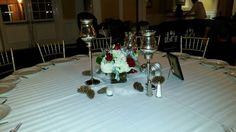 Cube of hydrangea and Heart roses surrounded by a trio of mercury glass candle stands. doristhefloristt.com