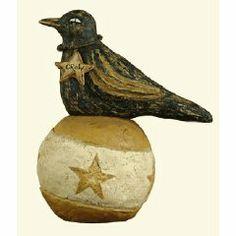 Primitive Folk Art Crow Sitting on a Ball at Old World Primitives