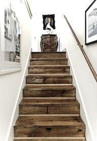 Elements--white/ecru walls, white trim, black accents, and rustic wood.