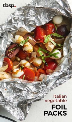 Tomatoes artichoke hearts and olives mingle inside tightly-wrapped foil packs then get topped with tiny pearls of mozzarella fresh basil and a drizzle of balsamic vinegar for what just might be the easiest side of summer. Grilling Recipes, Vegetable Recipes, Vegetarian Recipes, Cooking Recipes, Healthy Recipes, Foil Pack Meals, Foil Dinners, Healthy Snacks, Healthy Eating