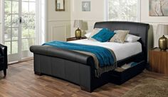 Santino faux leather bed frame. Upholstered in durable coated leather, this bed is both beautiful and practical. The bed frame comes with two drawers on either side ideal for linen or clothes.